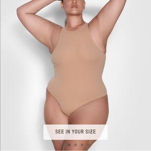 Skims high neck bodysuit medium like new